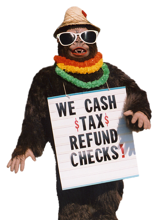 A gorilla statue with sunglasses and a sign around its neck, reading 'we cash tax refund checks'.