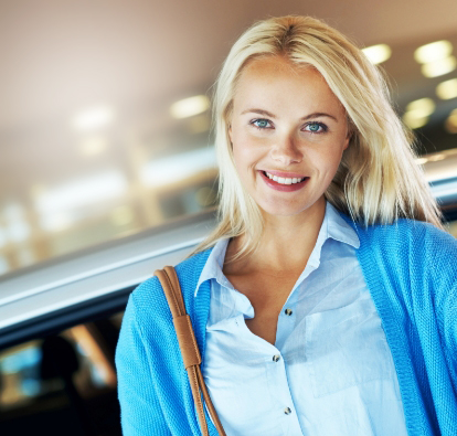 Smiling woman exiting a vehicle