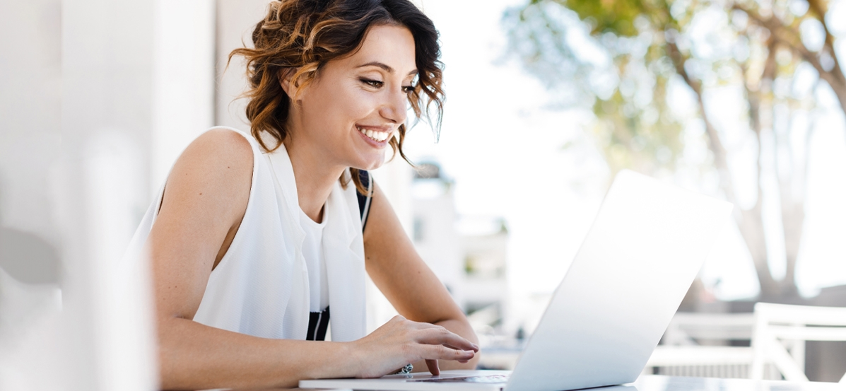 Woman smiling while on her laptop.