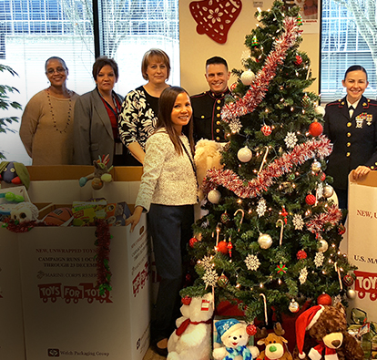 Moneytree team members with donations for toys for tots.